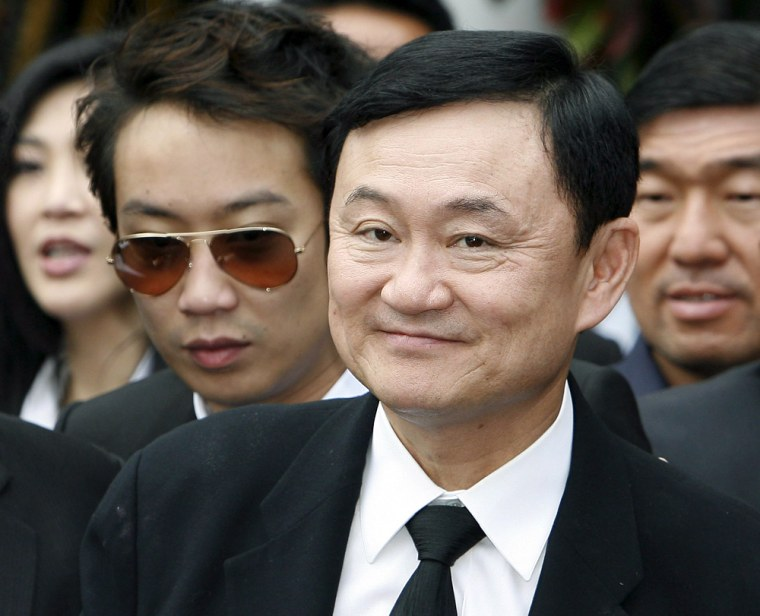 Image: Coup ousted premier Thaksin Shinawatra returns home to Thailand