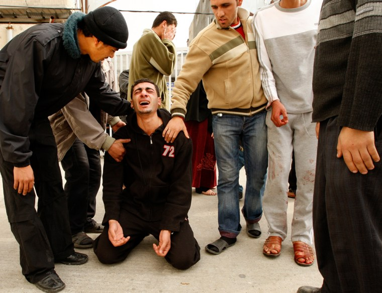 Image: A Palestinian man reacts after learning that his brother was killed by Israeli forces.