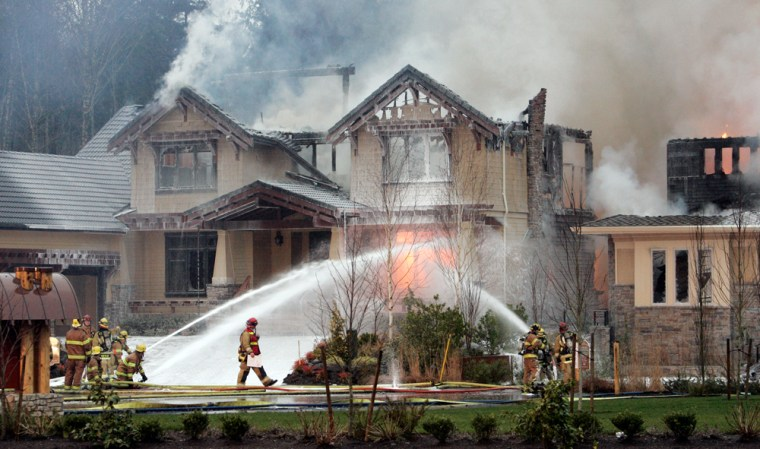 Image: Firefighters at the scene of house fire near Seattle.