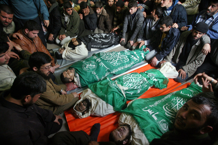 Image: Palestinians mourners attend the funeral of four Hamas militants