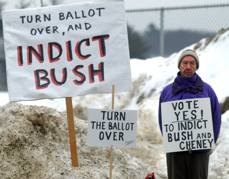 Image: A supporter of idicting President Bush in Brattleboro, Vermont.