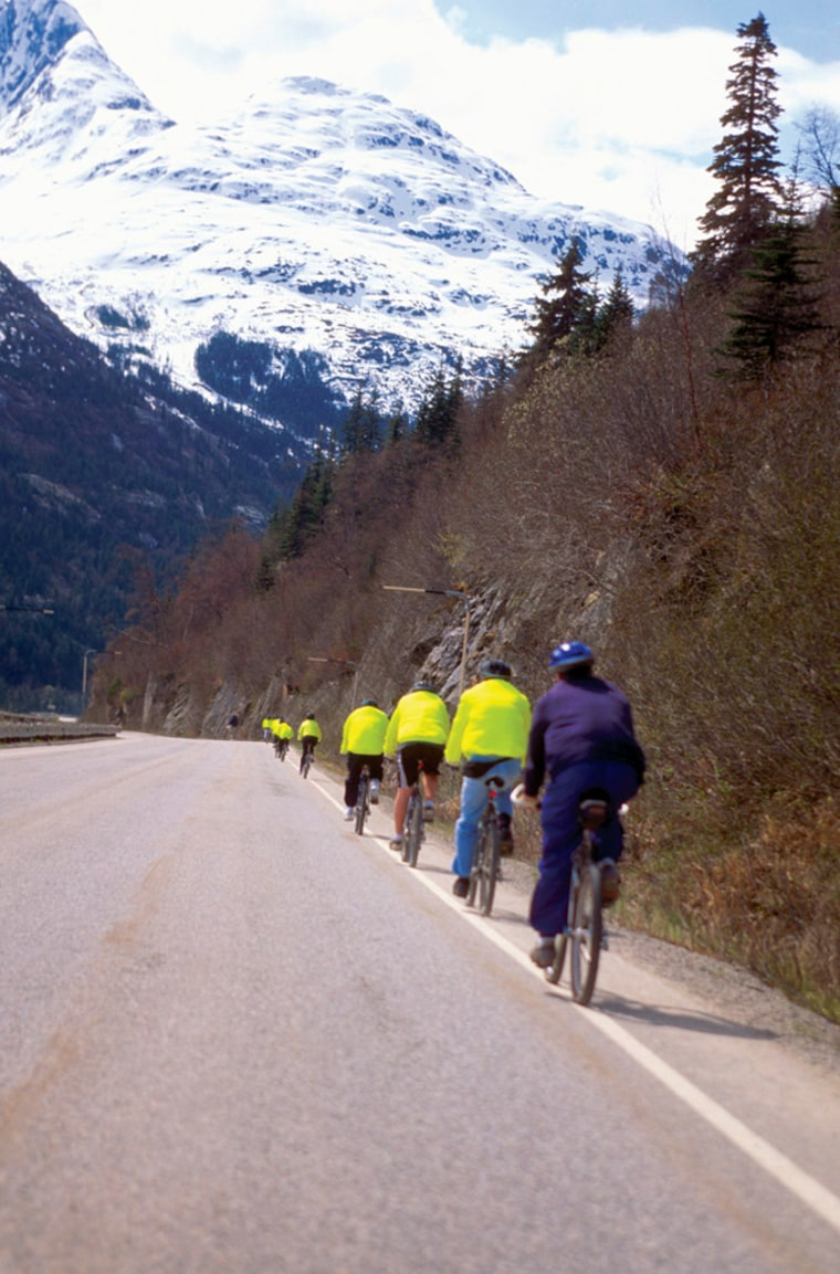 Image: Cyclists on White Pass Road, Skagway, Alaska
