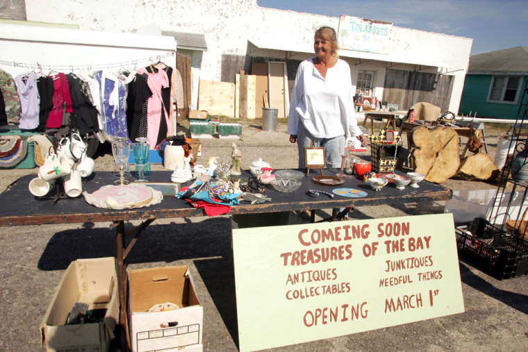 Image: Marilyn Theus looks over her roadside stand in Port St. Joe, Fla.