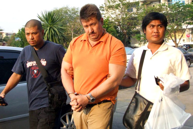 Thai police escort Russian suspected arms dealer Viktor Bout following his arrest in Bangkok on Thursday.
