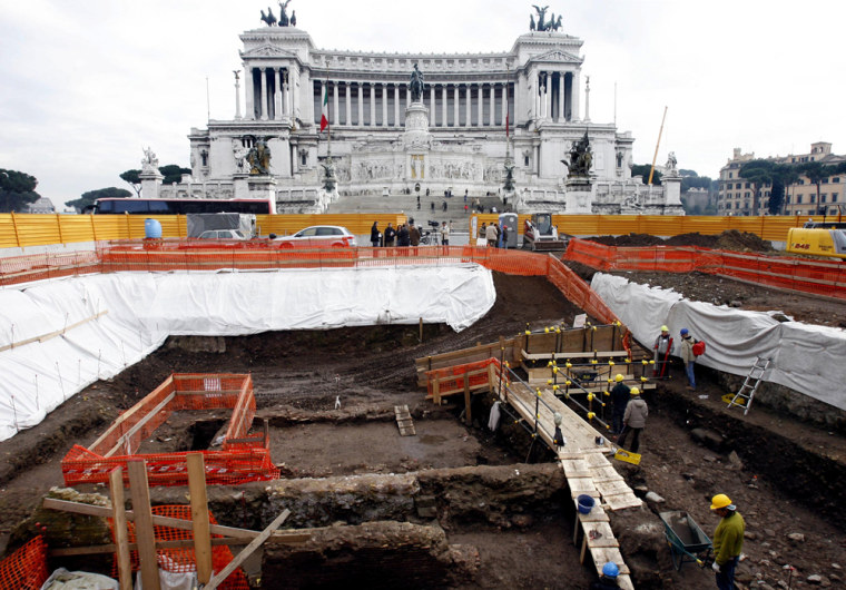 Image: Archaeologists work in an archaeological dig in Rome's central Piazza Venezia Square.