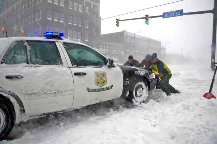 Image: Pushing a stuck patrol car