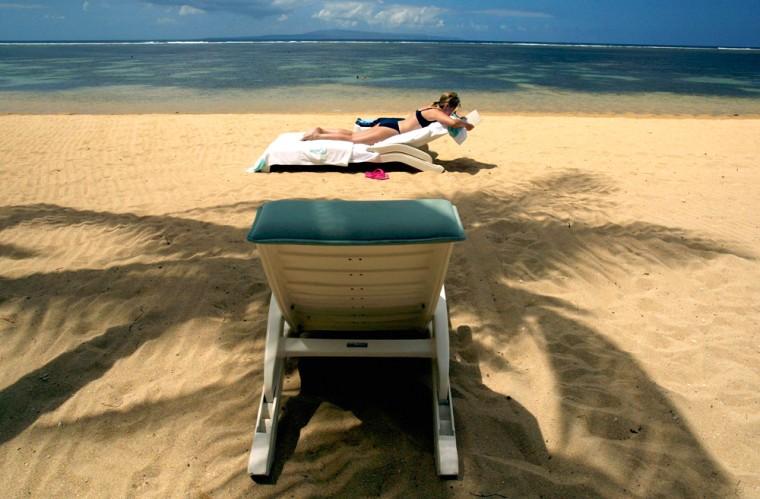 Image: A tourist sunbathes in Bali