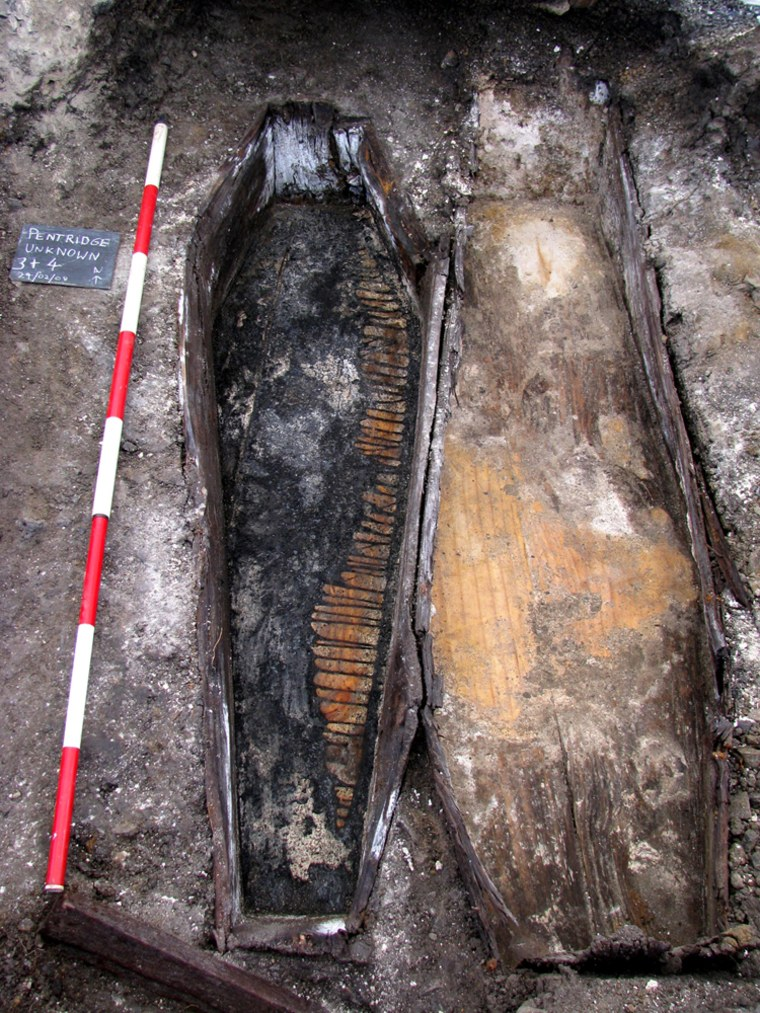 Image: One of the unearthed unmarked coffins, at the former Pentridge Prison site in Melbourne, is seen in this handout photograph