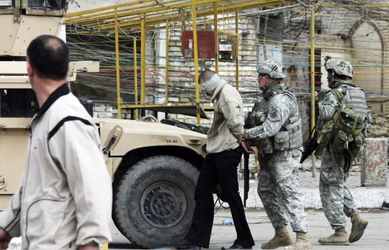 Image: American soldiers arrest a man suspected of being an al-Qaida member in Baghdad, Iraq