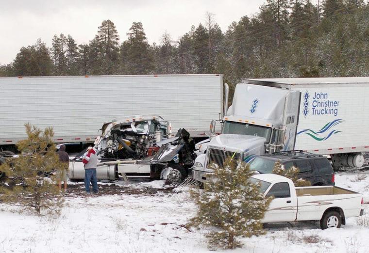 Image: Semi trucks and cars sit in a tangle on Interstate 40 near Flagstaff, Ariz.