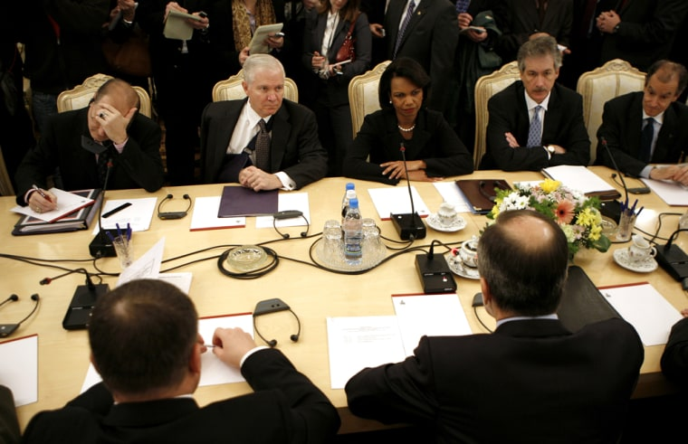 Image: U.S. Secretary of Defense Gates sits alongside U.S. Secretary of State Rice as they meet their Russian counterparts in Moscow