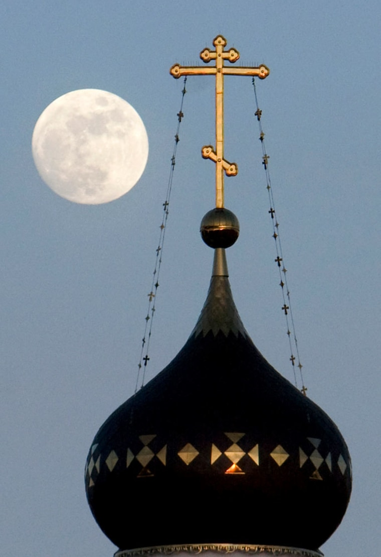 Image: full moon stands over an Orthodox
