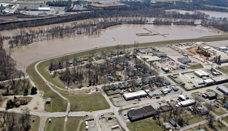 Image: A new levee holds back the floodwaters in Vally Park, Missouri.