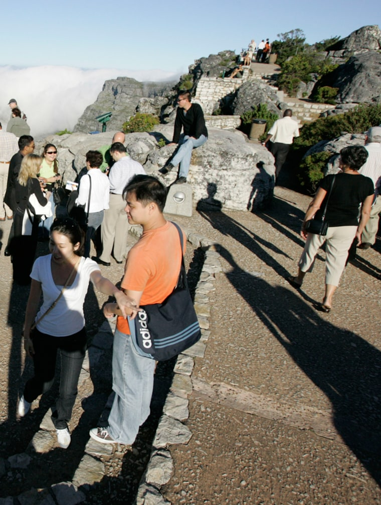 Image: Tourists stand around on top of Table Mountain Cape Town, South Africa