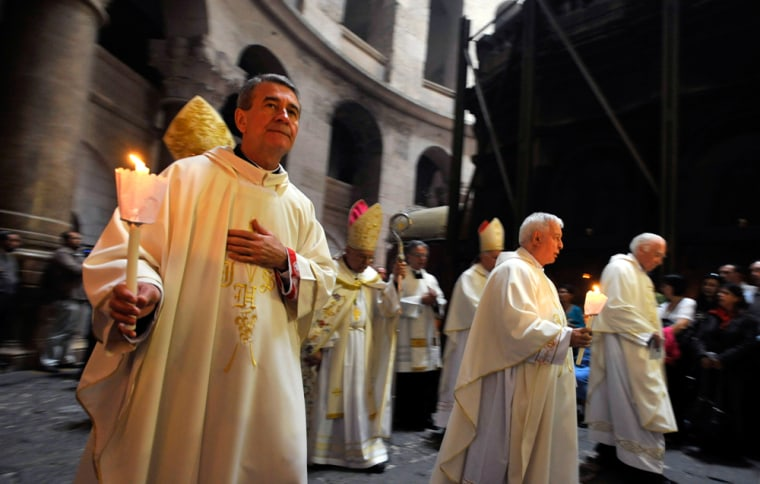 Image: Catholic clergy in a procession at the Church of the Holy Sepulchre in Jerusalem