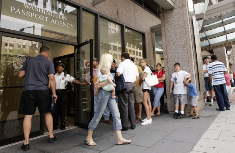 Image: People wait in line outside the U.S. Passport Office in Washington.