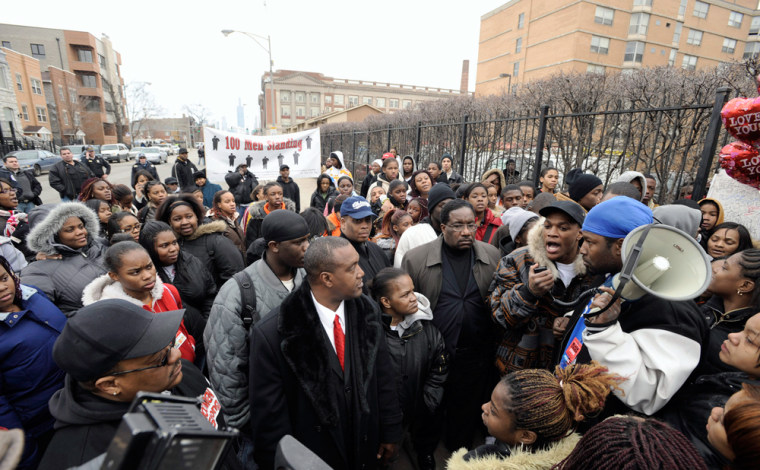 Image: High schools students, friends and supporters at a memorial for a slain student in Chicago.