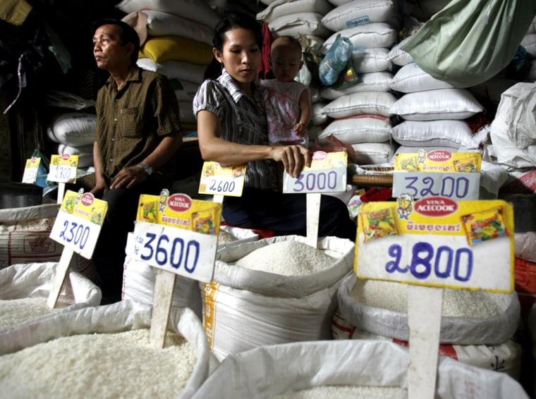 Image: Rice seller at Phnom Penh market