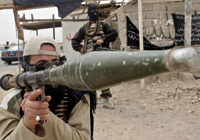 Mahdi Army fighters take positions in Basra, Iraq, Friday, March 28, 2008. Shiite militants clashed with government forces for a fourth day in Iraq's oil-rich south and sporadic fighting broke out in Baghdad, despite a weekend curfew in the capital.