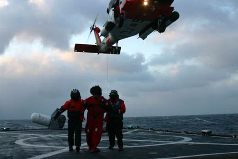 Image: A crew member of the Alaska Ranger taken on board the Coast Guard Cutter Munro