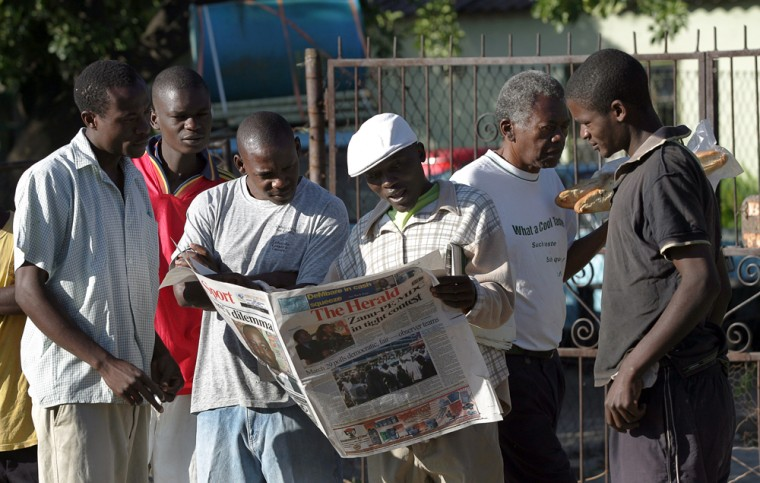 Image: Zimbabweans look for election results .