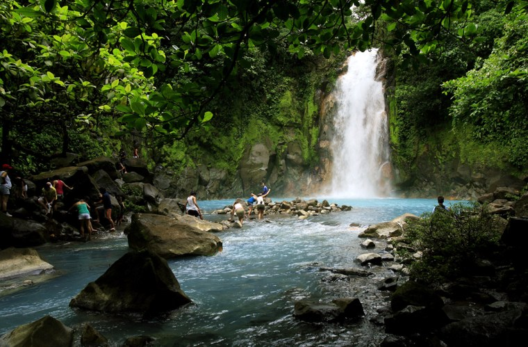 Image: People swim in the Celeste river waterfall at Tenorio Volcano National Park in Upala, Costa Rica.