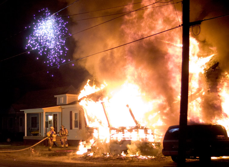 Image: Firefighters begin attacking a house fire along Pershing Avenue in Brockway, Pa.