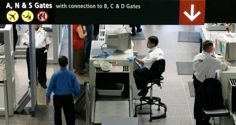 Image: TSA workers screen passengers at Seattle-Tacoma International Airport