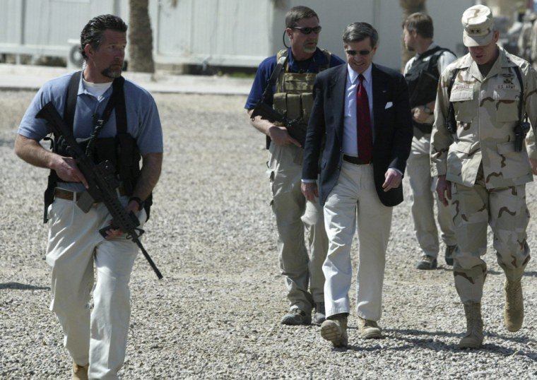 Image: U.S. civil administrator in Iraq Paul Bremer being escorted by Blackwater personnnel.