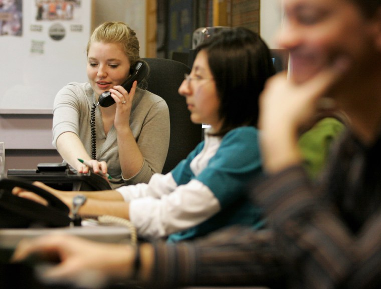 Image: Supervisor Cori Ballew, left, takes a call at the National Runaway Switchboard in Chicago