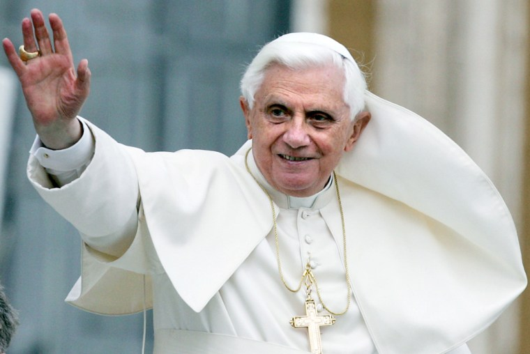 Pope Benedict XVI waves to faithful
