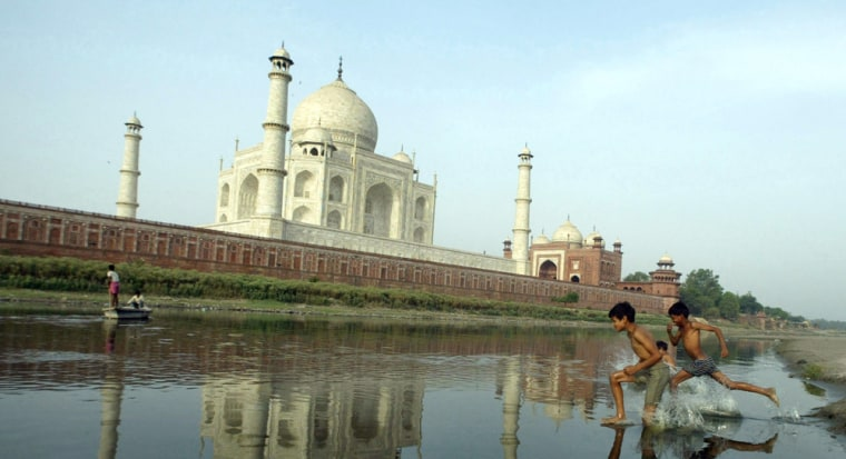 Image: Children play in the Yamuna River behind the Taj Mahal,