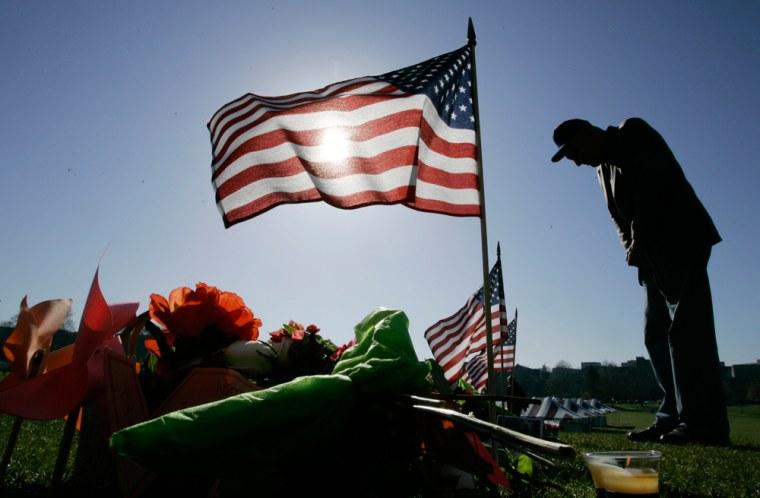 Image: Man stands at VA Tech memorial