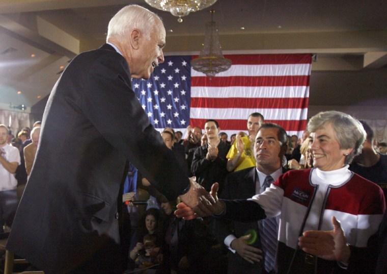 Image: Presumptive Republican US presidential nominee Sen John McCain greets a supporter during a town meeting Springfield Pennsylvania