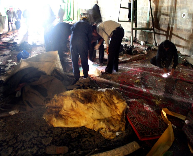 Iranians inspect the site of an explosion inside a mosque in Shiraz on Saturday.