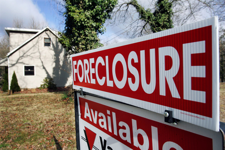 Image: Foreclosure sign in front of house
