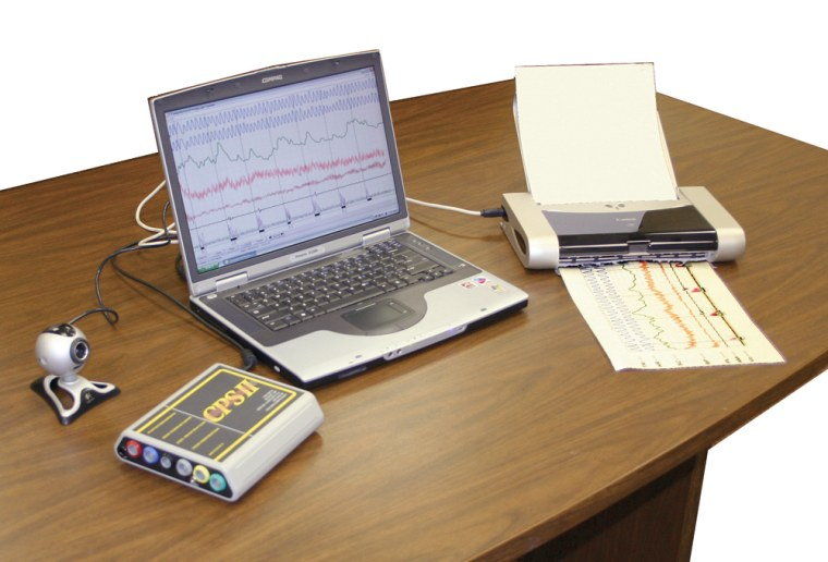 Image: Polygraph instrument hooked up to laptop and printer