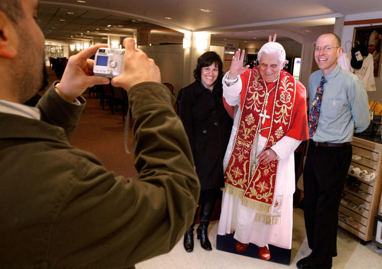 Image: tourists pose with Pope cutout