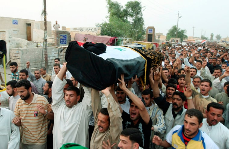 Image: Mourners chant slogans during a funeral for Riyadh al-Nuri in Najaf