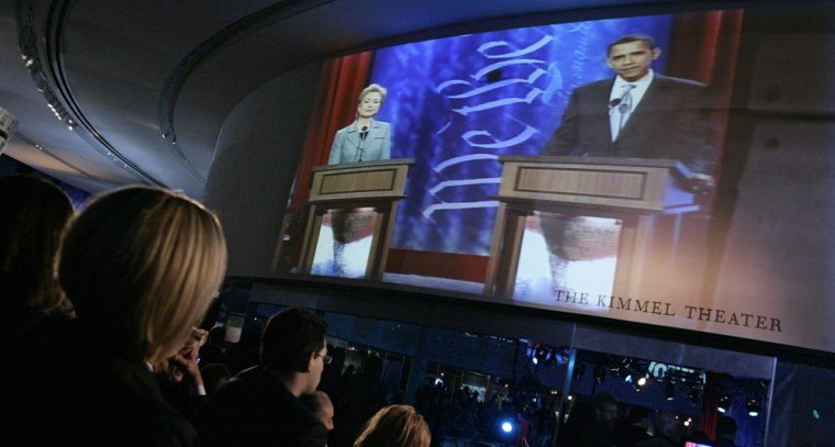 Image: US Democratic presidential candidates Senator Clinton and Obama are shown on video monitors in Philadelphia