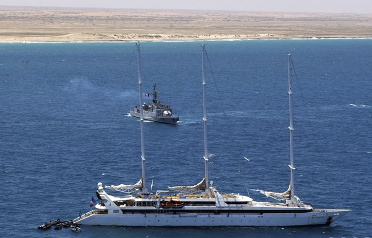 Zodiac commando boats, left, and a French navy frigate, arrive at the cruise ship Le Ponant, off Somalia's coast on Saturday. Helicopter-borne French troopshad earlier swooped in on Somali pirates after they released 30 hostages fromthe luxury 288-foot yacht.