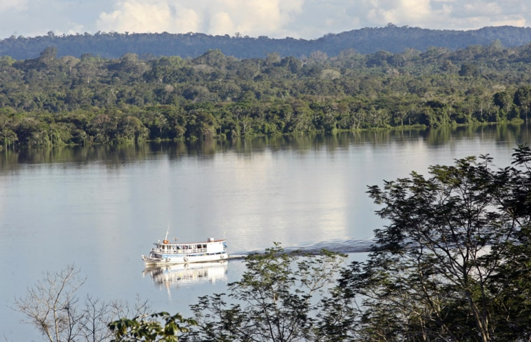 Image: A boat is seen in the Tapajos River, near the Amazonia National Park