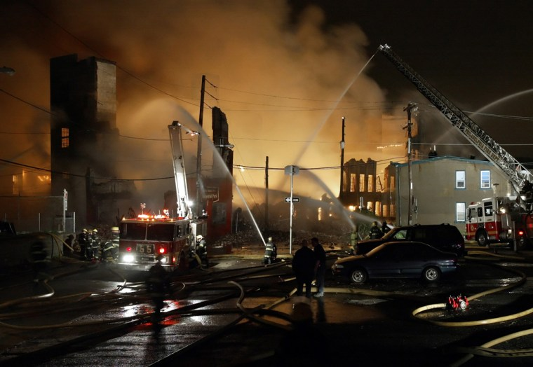 Image: Firefighters battle a seven alarm fire in a warehouse.