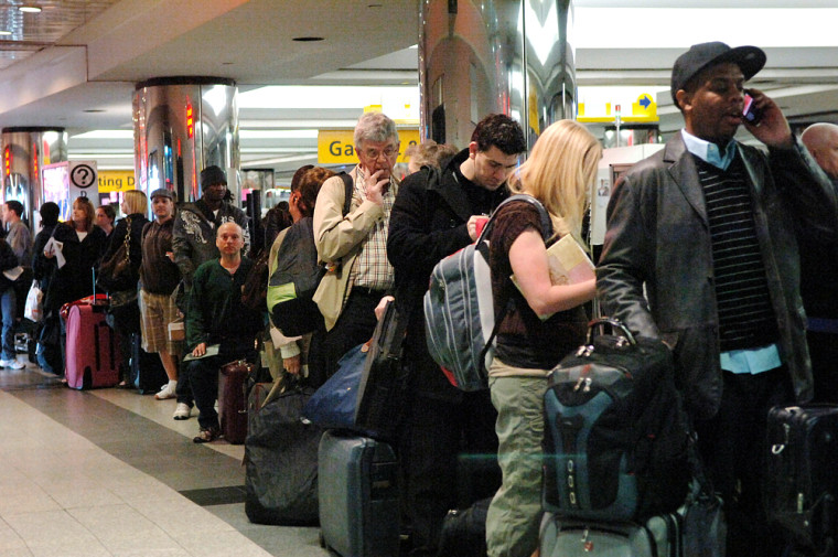 Image: Travelers in line at the American Airlines terminal in LaGuardia