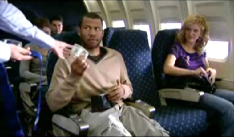 Passengers seem a little concerned about extra flight costs in this image from a Mad TV video.