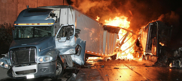 Image: Big rig truck burns at accident scene on Interstate 5 freeway north of Los Angeles