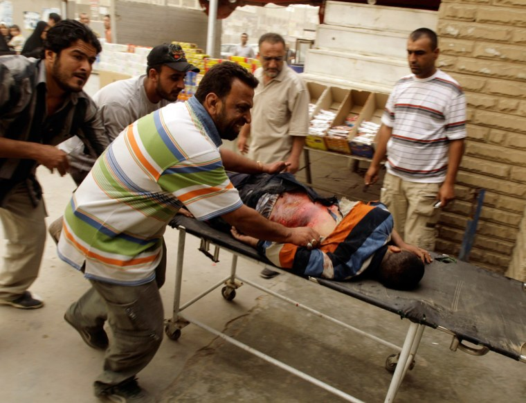 Image: An injured man is rushed to a hospita