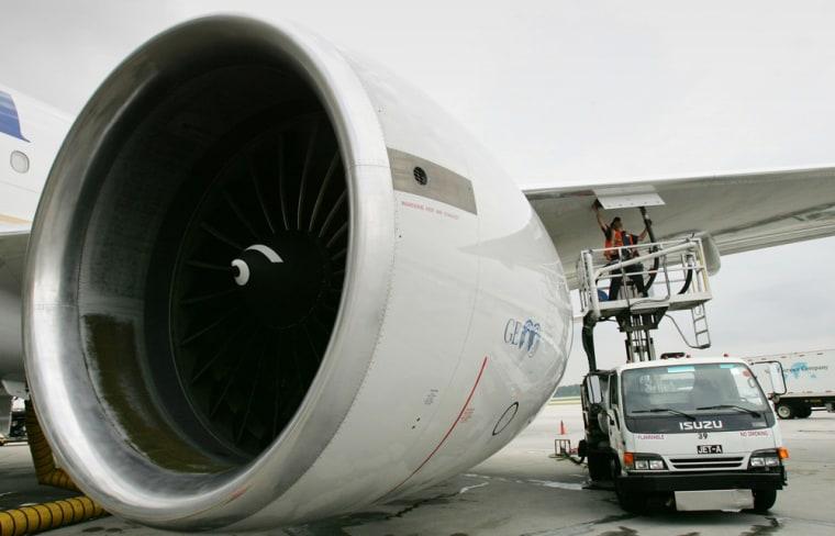 Image: worker refuels jet