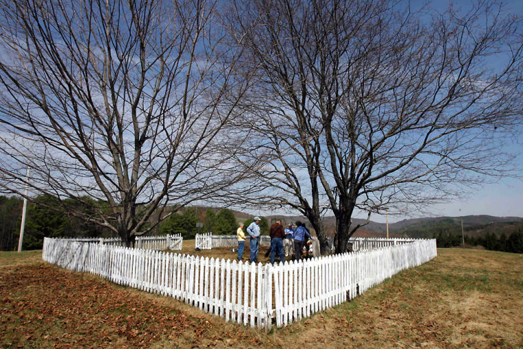 Image: Visitors stand in the Aldrich Cemetery in Hartland, Vt.