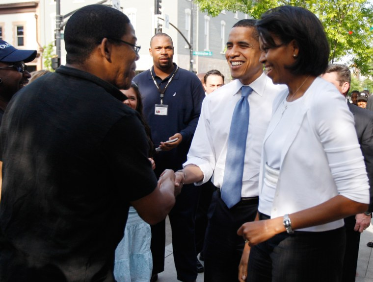 Image: U.S. Democratic presidential candidate Senator Barack Obama and his wife Michelle Obama meet with residents in Raleigh